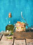 Healthy homemade jar quinoa salad with tomatoes, avocado, fresh basil. Healthy homemade jar quinoa salad with sun-dried tomatoes, avocado and fresh basil. Detox Royalty Free Stock Photo