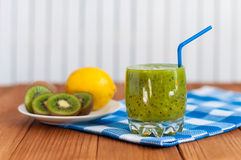 Healthy homemade kiwi juice in glass and fresh Stock Images