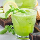 Homemade lemonade with cucumber, basil, lemon, honey and sparkling water, square format Royalty Free Stock Photo