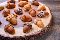 Healthy homemade Maple Acorn Cakelets, acorn shape cookies on wood slice serving board, server, tray. Closeup. Healthy homemade Maple Acorn Cakelets, acorn Royalty Free Stock Image