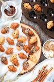 Healthy homemade Maple Acorn Cakelets, acorn shape cookies on wood slice serving board, tray. Top view Stock Photography