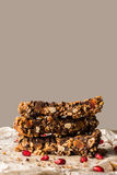 Healthy homemade muesli bar with cereals, chocolate and pomegran Stock Images