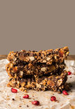 Healthy homemade muesli bar with cereals, chocolate and pomegran Royalty Free Stock Images