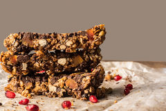 Healthy homemade muesli bar with cereals, chocolate and pomegran Stock Image
