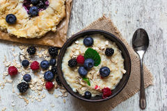 Healthy homemade oatmeal with berries and berry cake for breakfast. top view Stock Photography