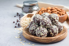 Healthy homemade paleo chocolate energy balls, horizontal, copy space. Healthy homemade paleo chocolate energy balls with rolled oats, nuts, dates and chia seeds Stock Images