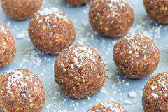 Healthy homemade paleo energy balls with carrot, nuts, dates and coconut flakes, on tray horizontal. Healthy homemade paleo energy balls with carrot, nuts, dates Stock Photo