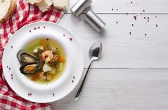 Healthy homemade seafood soup of white fish, shrimps and mussels Royalty Free Stock Photos