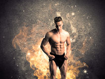 Healthy hot male showing muscles with fire Royalty Free Stock Photography