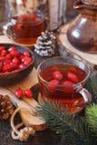 Healthy hot winter beverage. Rose hip tea and berries. Vitamin hot winter beverage. Rose hip tea and berries stock image