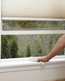 Healthy House. Male hand wiping off a window sill to reduce allergens in the home stock images