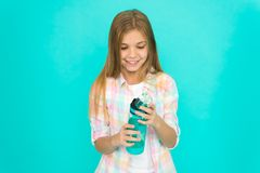 Healthy and hydrated. Pediatric disorders of water balance. Girl cares about health and water balance. Kid hold bottle. Blue background. Child girl long hair royalty free stock images