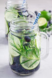 Healthy infused water with fresh blueberry, lime and rosemary, vertical Royalty Free Stock Image