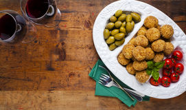 Healthy Italian Appetizer Platter with Risotto balls Arancini ,. Green Olives , Tomato and red Wine. Party Celebration Tray Royalty Free Stock Image