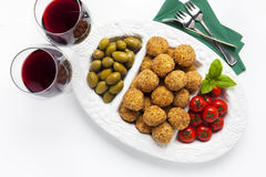 Healthy Italian Appetizer Platter with Risotto balls Arancini ,. Green Olives , Tomato and red Wine. Party Celebration Tray Royalty Free Stock Photo