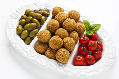 Healthy Italian Appetizer Platter with Risotto balls Arancini ,. Green Olives , Tomato and red Wine. Party Celebration Tray Stock Photo