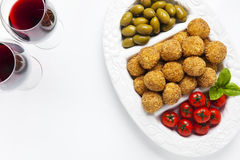 Healthy Italian Appetizer Platter with Risotto balls Arancini ,. Green Olives , Tomato and red Wine. Party Celebration Tray Royalty Free Stock Photos
