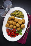 Healthy Italian Appetizer Platter with Risotto balls Arancini ,. Green Olives , Tomato and red Wine. Party Celebration Tray Stock Photos