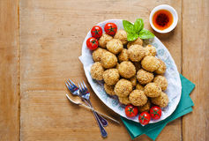 Healthy italian appetizer with risotto balls arancini , green ol. Ives , Tomato and red Wine Royalty Free Stock Images