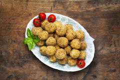 Healthy italian appetizer with risotto balls arancini , green ol. Ives , Tomato and red Wine Royalty Free Stock Photo