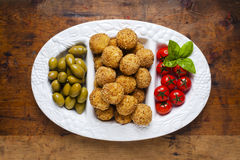 Healthy italian appetizer with risotto balls arancini , green ol. Ives , Tomato and red Wine Stock Images