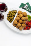 Healthy italian appetizer with risotto balls arancini , green ol Royalty Free Stock Images