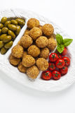 Healthy italian appetizer with risotto balls arancini , green ol. Ives , Tomato and red Wine Royalty Free Stock Image