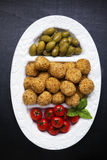 Healthy italian appetizer with risotto balls arancini , green ol Royalty Free Stock Photo