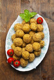 Healthy Italian Appetizer with Risotto Balls Arancini , green Ol. Ives , tomato and red Wine Stock Photography