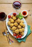 Healthy Italian Appetizer with Risotto Balls Arancini , green Ol. Ives , tomato and red Wine Stock Photo