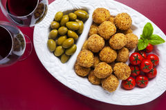 Healthy Italian Appetizer Tray with Risotto balls Arancini , Gre. En Olives , Tomato and red Wine. Party Celebration Wedding Royalty Free Stock Image