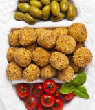 Healthy Italian Appetizer Tray with Risotto balls Arancini , Green Olives , Tomato and red Wine. Party Celebration Wedding stock images