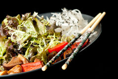 Healthy Japanese salad on the black plate Royalty Free Stock Images