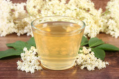 Healthy juice and elderberry flowers on board, alternative medicine concept Stock Photography