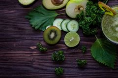 Healthy Juice. Green smoothie, Organic and Fresh green vegetable for detox, diet and weight loss on the wood background, top view stock photos