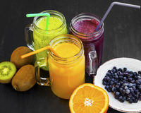 Healthy juices drinks with kiwi,blueberries and orange Royalty Free Stock Image