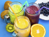 Healthy juices drinks with kiwi,blueberries and orange Stock Images