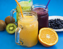 Healthy juices drinks with kiwi,blueberries and orange Stock Photo