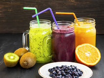 Healthy juices drinks with kiwi,blueberries and orange Stock Photos