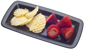 Healthy and Junk Food Snack. Including Strawberries and Potato Chips on a Dish Isolated on White with a Clipping Path Stock Photo