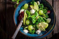 Healthy kale salad with avocado, lettuce and grape Royalty Free Stock Images