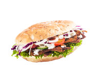 Healthy kebab or döner. Healthy salad roll, kebab or döner with fresh lettuce, tomato, onion and cucumber with cripsy cooked meat isolated on white royalty free stock images