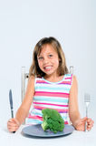 Healthy kid eating broccoli Royalty Free Stock Images