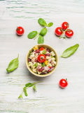 Healthy kidney beans salad with Goat cheese and tomatoes on light rustic background Royalty Free Stock Photo