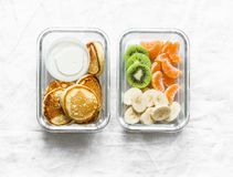 Free Healthy Kids School Lunch Box - Pancakes With Sour Cream And Banana, Kiwi, Tangerine. Delicious Snack On A Light Background Stock Images - 141148474