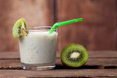 Healthy kiwi smoothie in a glass. Selective focus Royalty Free Stock Photos