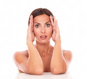 Healthy latin female touching her face Royalty Free Stock Image