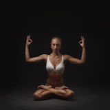 Healthy latino woman doing yoga Stock Photos