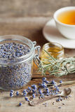 Healthy lavender herbal tea and honey jar Stock Photos