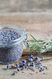Healthy lavender tea in jar and dry lavender flowers. Royalty Free Stock Image